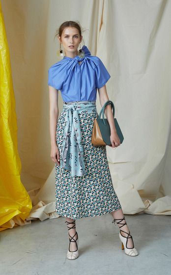 The designer: It's a new era under recently-minted creative director Francesco Risso (who spent ten years at Prada). Recognized by her boxy shapes and artsy beat, the Marni woman is enjoying a dose of fresh femininity for Resort.     This season it's about: Large bows, mixed micro florals and a palette of pinks and blues usher in a newfound prettiness, without compromising Marni's cool factor. Plus, a formal ankle-length trapeze dress marks a new entrée into evening.