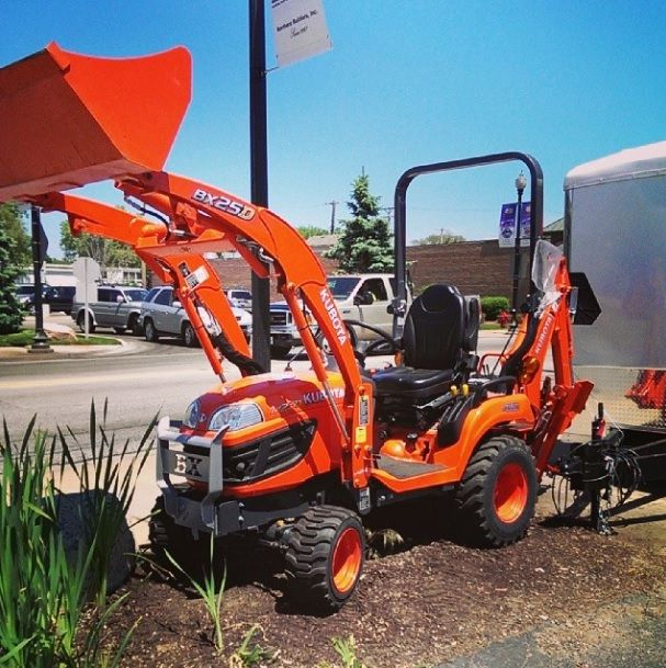 Kubota BX250 on display outside.