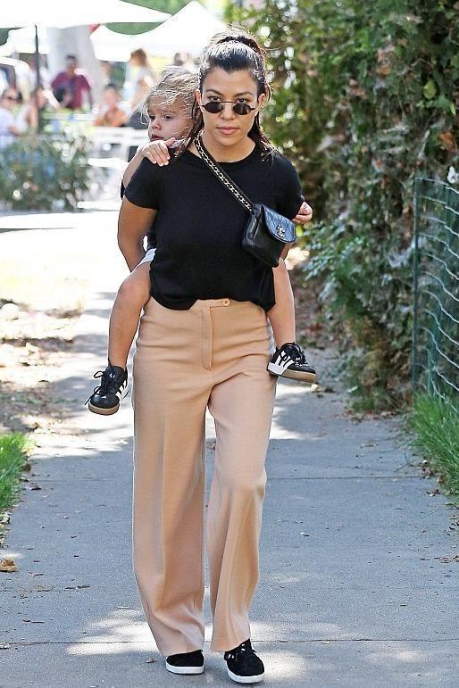 c9f4227a74e6 Kourtney Kardashian wearing Chanel Vintage Quilted Bag Chain Belt Fanny  Pack, Roberi & Fraud Doris 2.0 Sunglasses, Adidas Originals Gazelle  Sneakers and ...