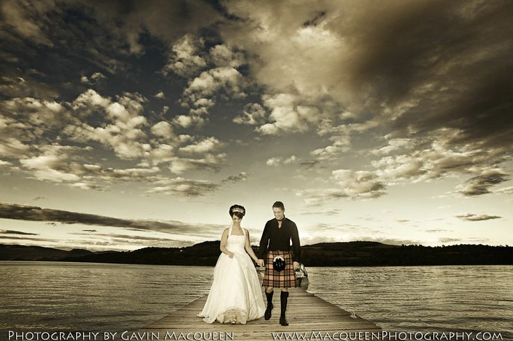 The Bride and The Groom at The Duck Bay Marina, Loch Lomond, at dusk.  Wedding photography by Gavin Macqueen.