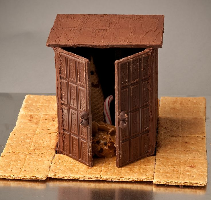 The Lion and the Witch in the Wardrobe by Rachel Fenske, inspired by the book The Lion, the Witch, and the Wardrobe by C. S. Lewis. Foods used: Hershey's bars, chocolate frosting, chocolate chips, sugar cones, candy cane, Cadbury egg, peanut butter, graham crackers.