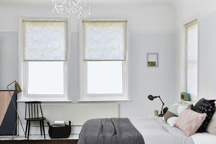 Sheer white bedroom window blinds with a golden print [Nature Spring Twig] create a scandinavian style in this bedroom.