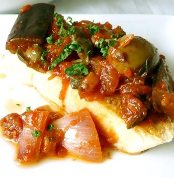 Caponata is a vegetarian dish that's centered around eggplant and fresh, harvested vegetables. Get the Sicilian recipe and wine pairing here: http://eat.snooth.com/articles/eric-guidos-caponata/