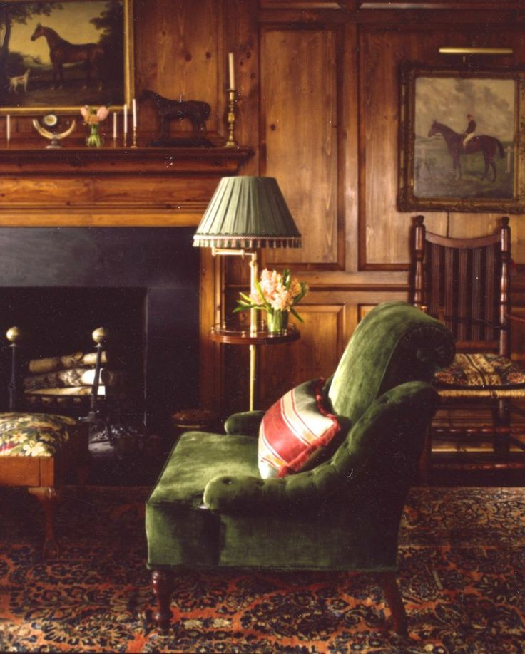 green velvet chair, equestrian paintings, warm paneling - Anne Miller Interiors