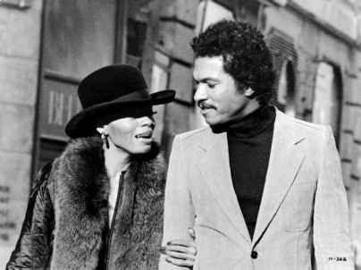 they looking good.. she working that coat and hat.. he working that turtle neck and that hair