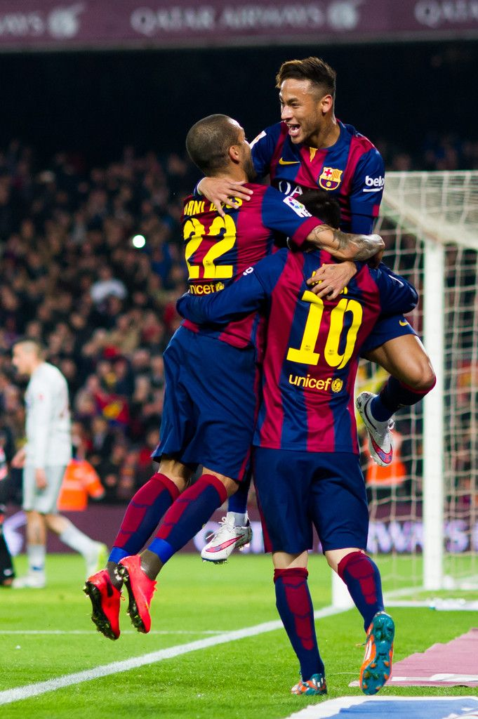 Neymar Santos Jr (top) of FC Barcelona celebrates with his teammates Dani Alves and Lionel Messi after scoring the opening goal during the La Liga match between FC Barcelona and Club Atletico de Madrid at Camp Nou on January 11, 2015 in Barcelona, Catalonia.