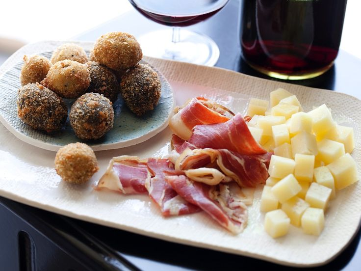 Give your evening Spanish flair with a selection of tapas, including fried olives, Manchego cheese and Serrano ham.