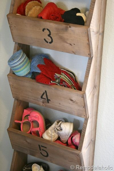 Wall storage bins - nice idea to contain the winter accessories, although this is a little too rustic looking for my taste.