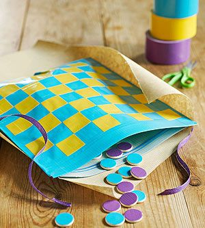 Checkers Mate: Duct tape turns a ziplock bag into a game board that holds handmade playing pieces.