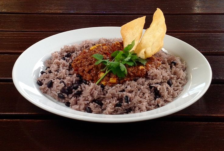 """""""Chili con Carne"""" with chipotle peppers , corn, roasted tomatoes , garlic, rice…"""