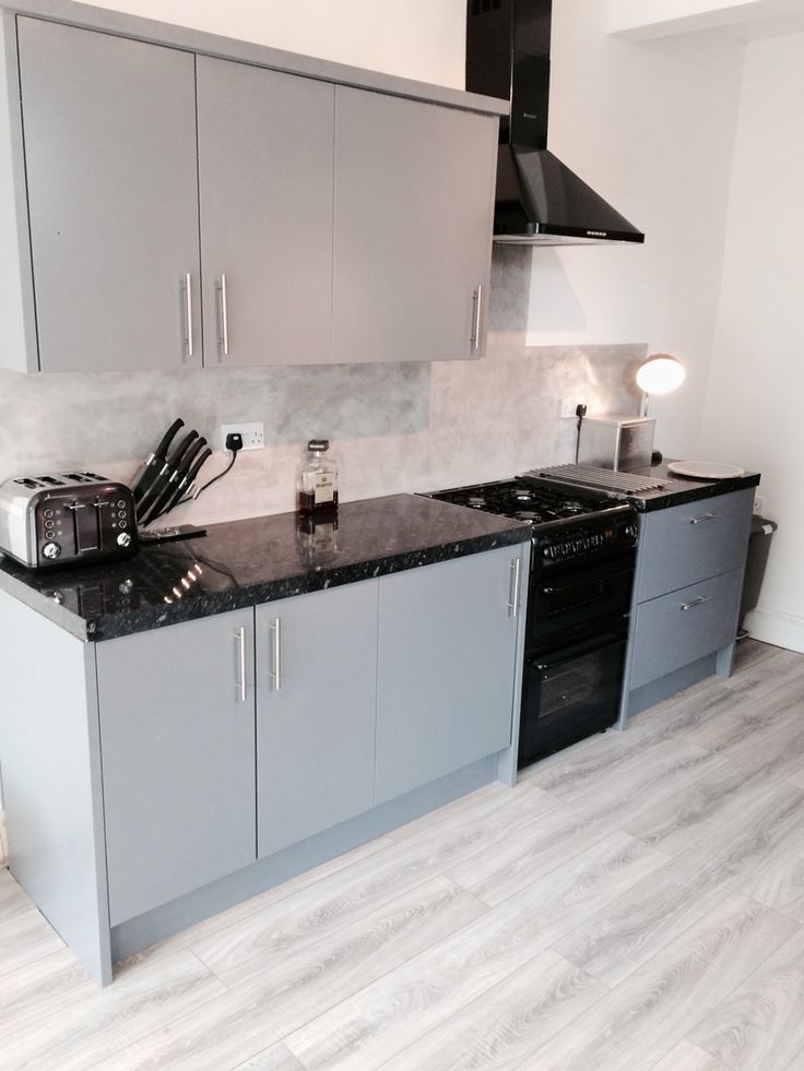 Grey and black kitchen , grey oak floor, Venetian polished plaster