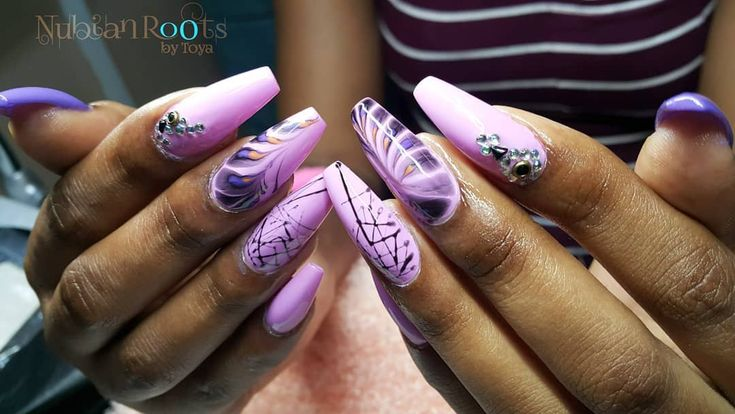 Nails done at Nubian Roots by toya. For more information on products and service