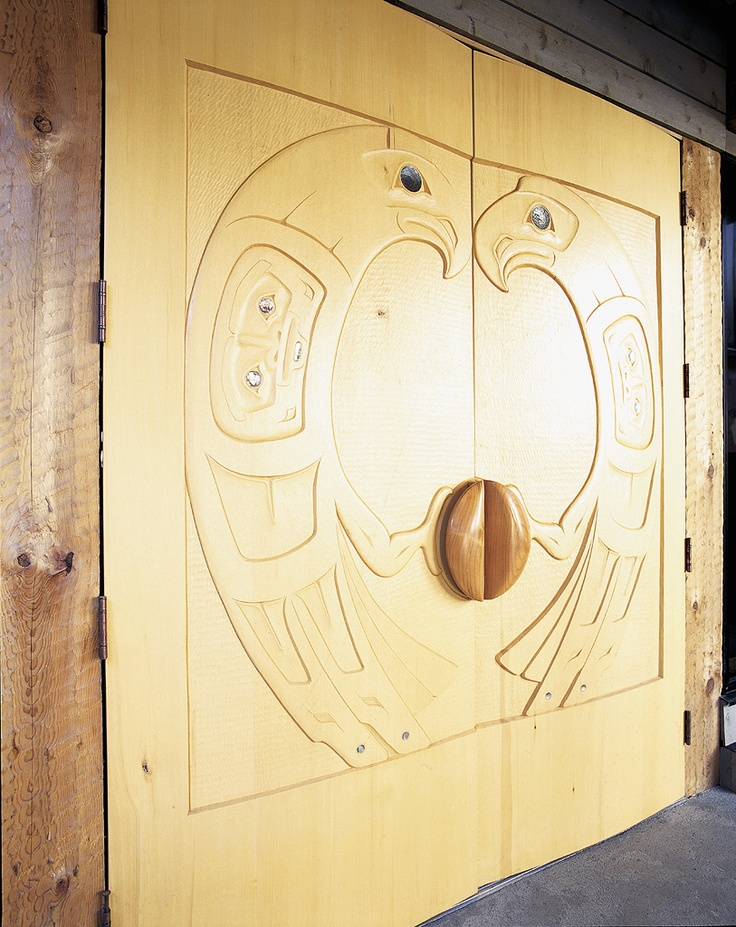 Even the front doors are works of art.  These were hand carved by the legendary Henry Nolla himself.