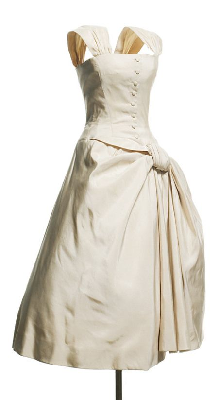 Christian Dior 1954-55 Curaçao dress, Autumn-Winter 1954-1955 Haute Couture collection, H line. Cocktail dress in ivory silk faille. Bodice top with wide, gathered straps. Wide skirt with bow effect on left hip.