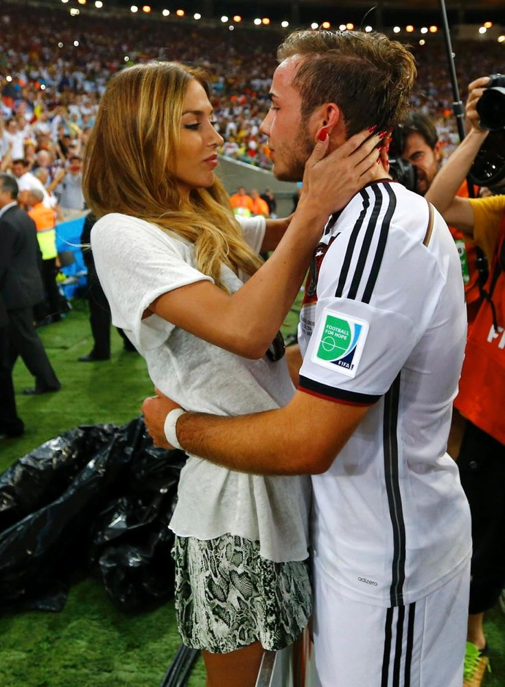 Germany's Mario Gotze, who scored the game-winning goal, kept his eyes on the prize ... and we're not talking about the coveted World Cup trophy. The soccer player immediately cozied up with stunning girlfriend Ann-Kathrin Brommel following Germany's win.
