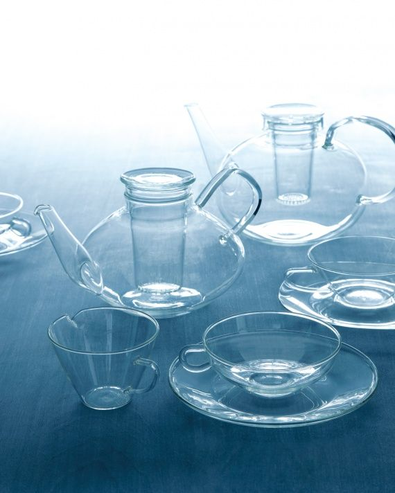 Tea-Service Pieces. Tea-Service Pieces. Whether vintage or reproduction, Jenaer glassware can handle very high temperatures. The teapot, top, and teacup, bottom right, are reissues of 1931 Bauhaus designs by Wilhelm Wagenfeld. The vintage teapot, middle left, teacup, middle right, and creamer, bottom left, are Heinrich Loeffelhardt's late-1950s updates of Wagenfeld's originals, designed with angles better suited for automated production.