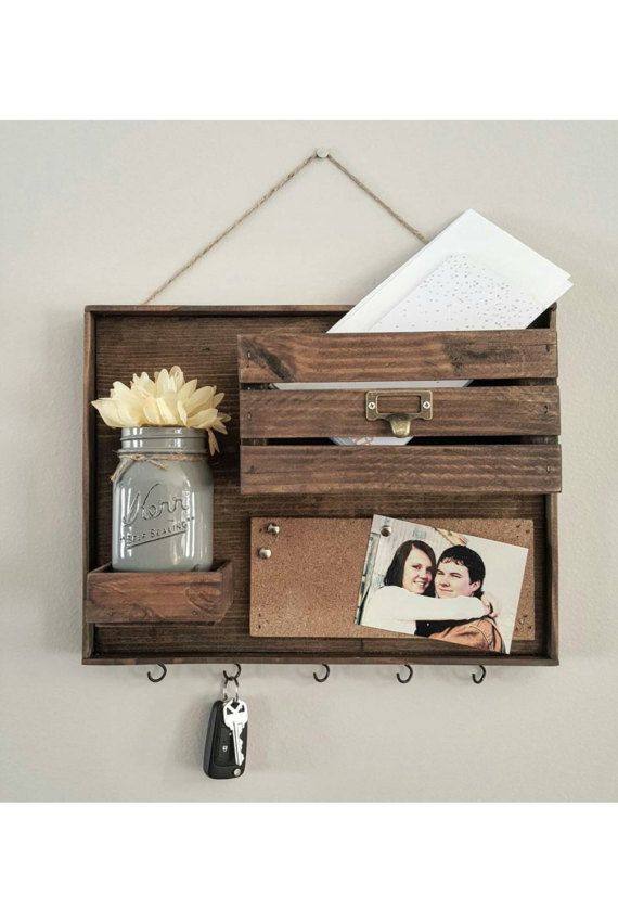 This adorable piece is a mail holder, key hanger, and push pin board all in one! Highly functional and cute! Sawtooth hangers are attached to back for easy hanging. Decorative hanging rope included as well. Dimensions are 15 wide x 12 tall and 4 deep. Pictured color is Ash. Mason jar colors pictured are grey and olive green. *Keyhooks will need to be screwed in by buyer to avoid them breaking off during shipping. Small predrilled holes will be on the bottom side to easily screw them in.*