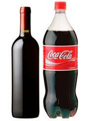 Interesting-- Coke and red wine make a perfectly delightful combination when mixed about 50-50 and well iced. The wine cuts the sweetness of the Coke, and the Coke adds zing to the wine. And it travels. Easily.    To prepare:    Take a 1.5-liter bottle of Coke and pour out half. Pour in one 750-mililiter bottle of dry (and cheap) red wine. Seal the bottle. Dispense into red Solo cups full of ice. Repeat.
