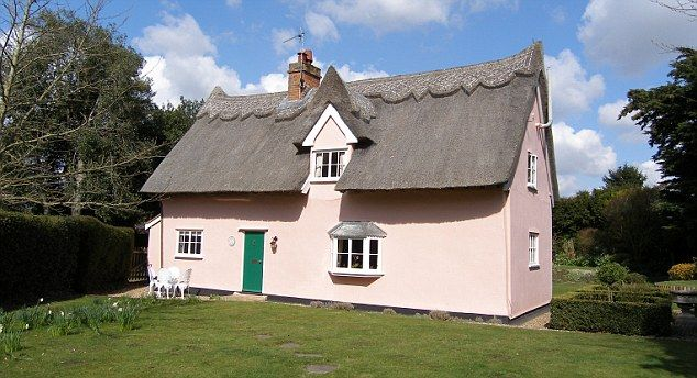 A thatched cottage in Stutton, England painted the proper ...