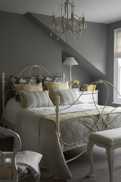 Gray bedroom with yellow accents- love the bed and the chandelier!!! This room is so inviting!