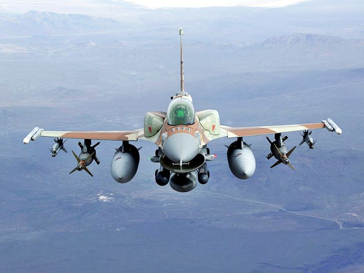 A General Dynamics F-16 Fighting Falcon with a balanced payload of weaponry & external fuel pods for additional range.