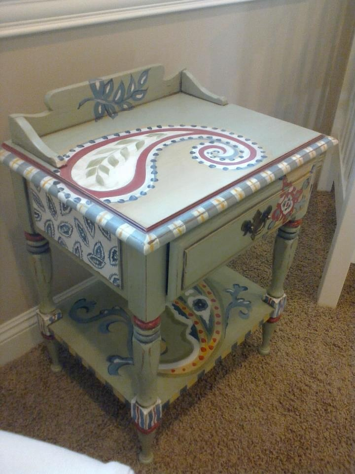 Hand painted end table for baby nursery.