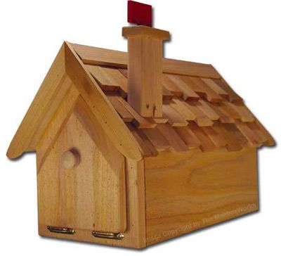 Made of all cedar construction this decorative wooden mailbox features a shake roof. The flag to signal outgoing mail is designed into the chimney, one touch returns the flag to closed position.