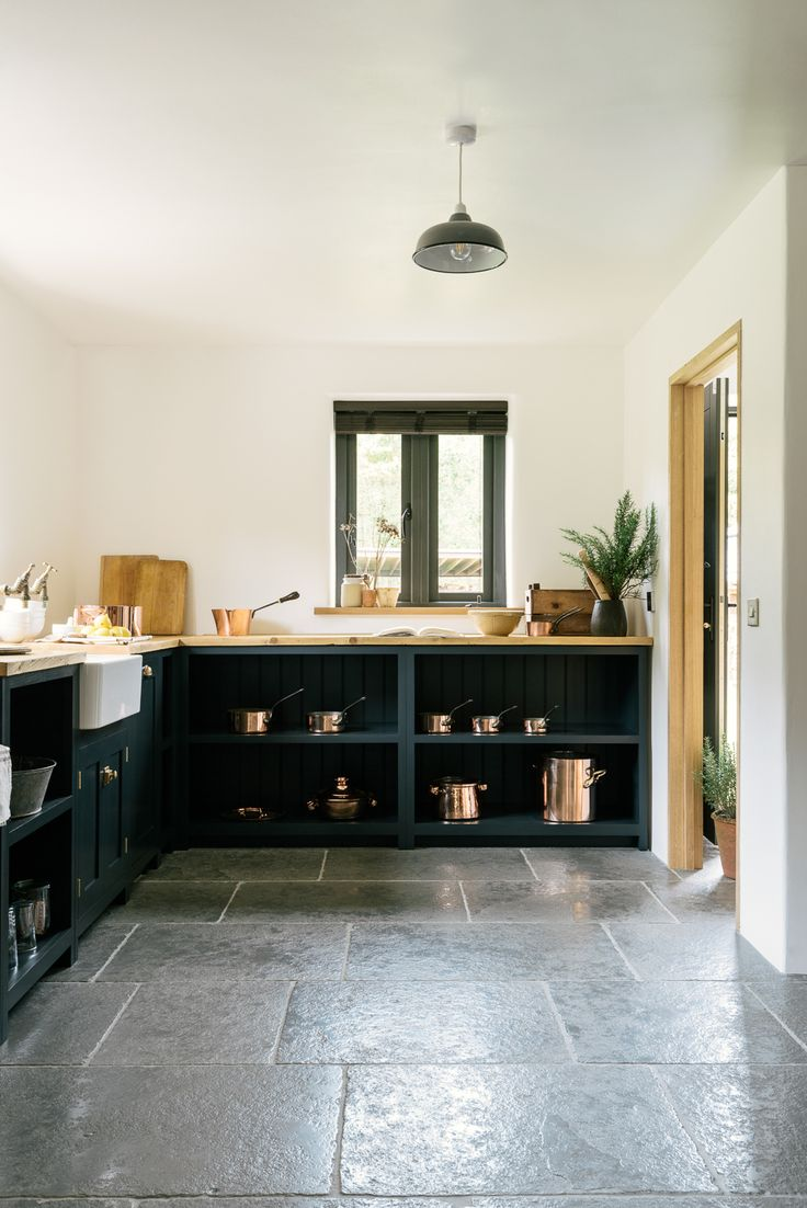 The Worn Grey Limestone by Floors of Stone works so perfectly in this stylish deVOL Kitchen