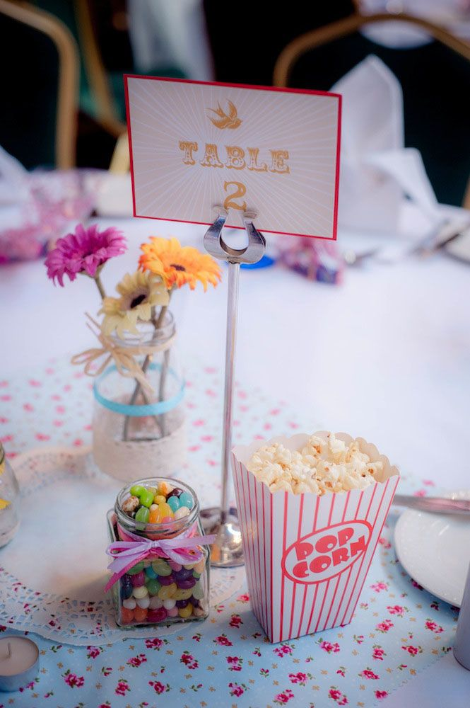 my wedding table edible centre pieces! retro popcorn, jellybeans. vintage materials. DIY vases