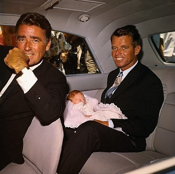 Peter Lawford and Bobby Kennedy with baby Robin Lawford.  Bobby was Robin's godfather.