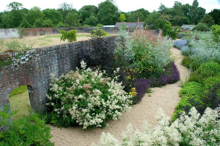 Paths and walls in garden on Thames in Oxfordshire, designed by Dan Pearson.