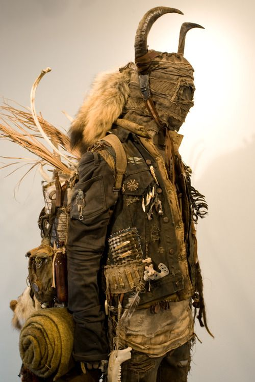 """Distressed, dusty look.  Natural """"found"""" elements: bone, feathers, fur, leather."""