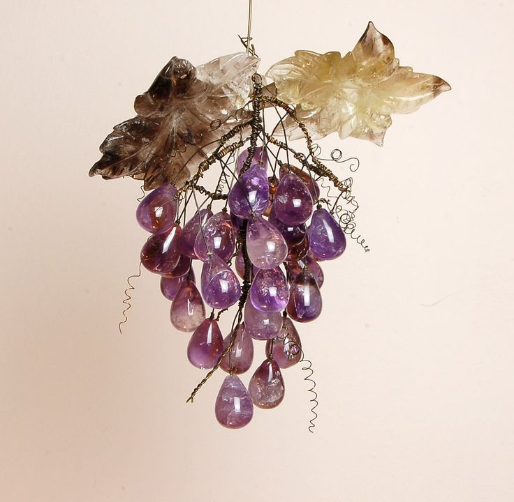 Naturalistically carved Amethyst Grape Bunch decorative object.