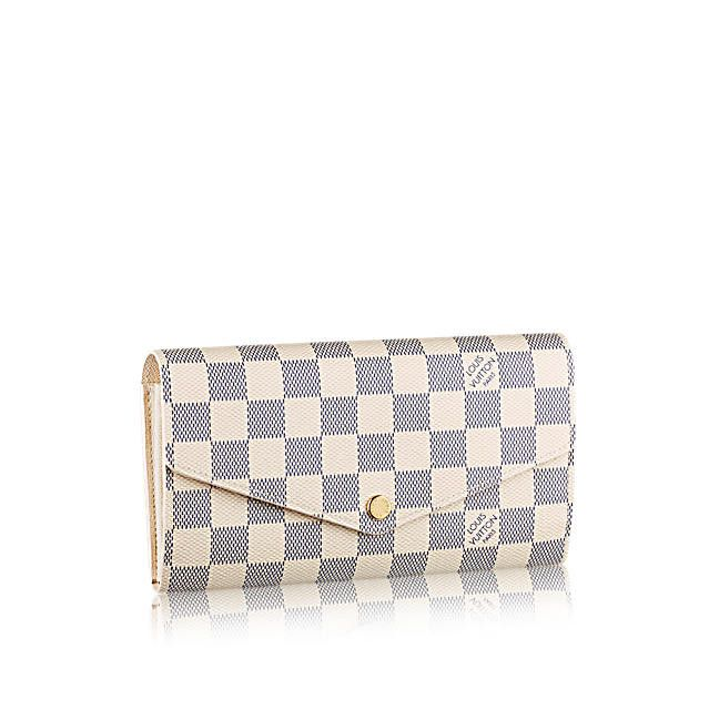 Discover Louis Vuitton Sarah Wallet  This envelope-style Sarah wallet  combines an eye-catching exterior in bold Epi Tropical leather with an  ingeniously ... e74299b36c