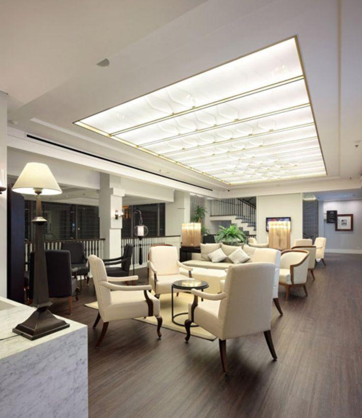 Interior design interior design of clinic interior design erha clinic surabaya by hmp for Dermatology clinic interior design