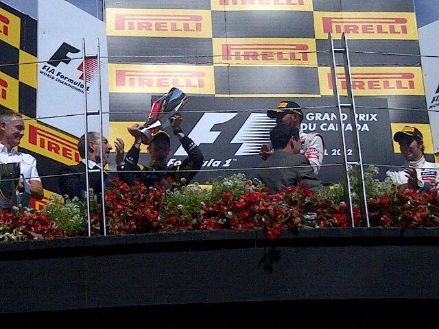 2012 Podium: Romain Grosjean (2nd), Lewis Hamilton (1st), Sergio Perez (3rd)
