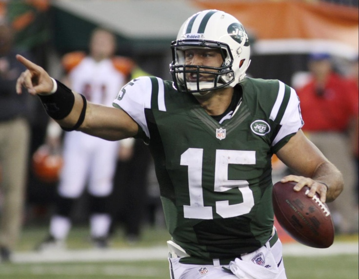 New York Jets quarterback Tim Tebow looks downfield in the first half of an NFL preseason football game against the Cincinnati Bengals