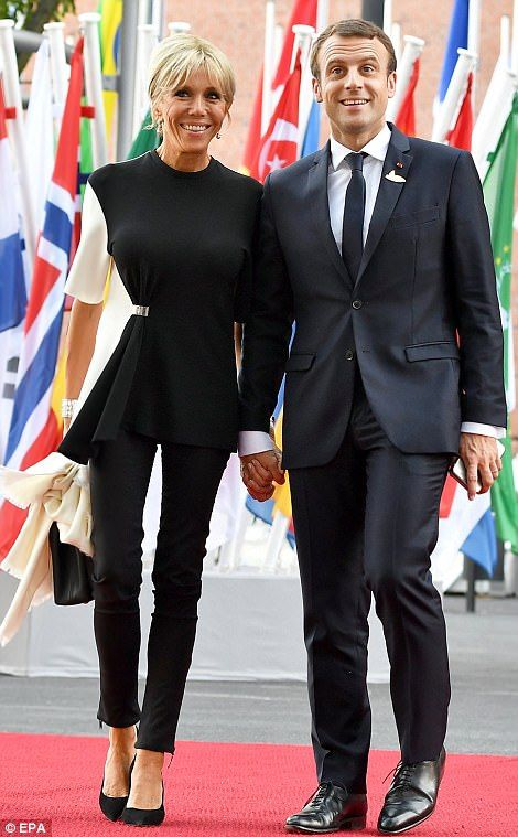 French President Emmanuel Macron and his wife Brigitte Macron  http://www.dailymail.co.uk/news/article-4674854/Theresa-s-husband-joins-G20-spouses-Hamburg-tour.html#ixzz4mCDD5oNI