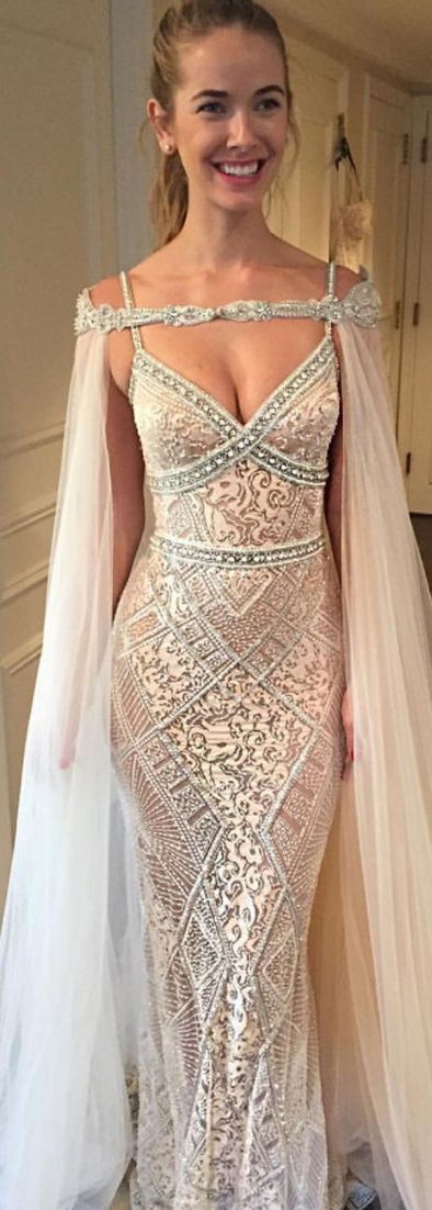 No cape but the dress is gorgeous