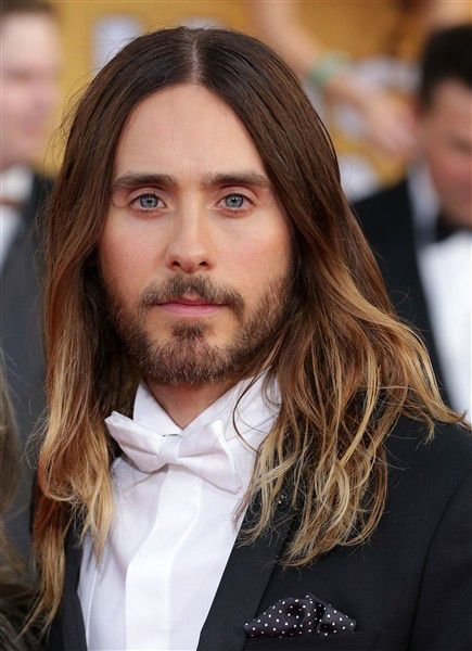 It's difficult not to feel envious of Jared Leto's long, ombre locks that look messy and yet perfect at the same time. But did you know that the 30 Seconds to Mars rocker has changed up his mane drastically over the years? From a magenta mohawk to cornrows and more, click through to vote on the hottie's varying hairstyles. We assume that men and women alike are jealous of Jared Leto's shiny tresses. If only we all could DO beachy, sun-kissed waves so effortlessly.