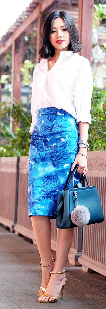 White embellished shirt with a blue floral skirt