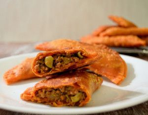 Puerto Rican Picadillo is a ground beef hash made with beef, potatoes and sofrito. The picadillo is then used in empanadas or papa rellenos.