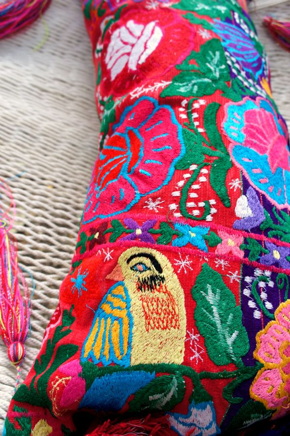 This stunning colorful pillow cover was made using a vintage men's poncho from Chiapas, which is in southern Mexico. The poncho is a traditional clothing item used by men in the area of Zinac…