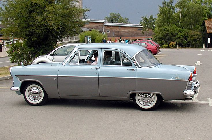 1956–1962 Ford Zodiac Mark II. The Mark II Zodiac was slightly altered to distinguish it from the lesser variants, having more elaborate tail-end styling and at the front a different grille. The auxiliary lamps and wing mirrors were deleted from the Zodiac range but it retained two-tone paint, whitewall tyres, chrome wheel-trim embellishers and gold plated badges.