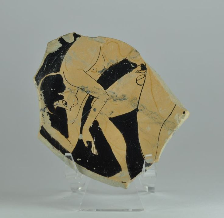 Greek Attic red figure kylix with Greek homosexuality erotic scene, 5th century B.C. Greek Attic red figure kylix fragment with nude young boy in position to receive sex from another man. Also if the scene is incomplete boy haven't nothing in hands and there is no parellel of this position that is sex scene. In Athenian aristocratic circles homosexual were viewed as a key element in the socialization of youths, involving elements of mentoring as well as eroticism, 8 cm wide. Private…