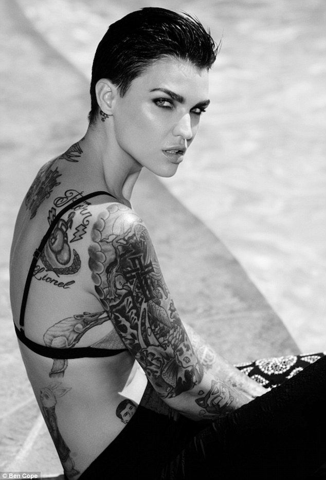 Art attack: Ruby Rose cut an androgynous figure in menswear-inspired outfits for an edgy black and white shoot in American arts magazine WeTheUrban
