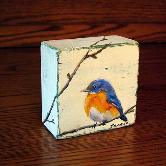MADE TO ORDER - Each painting is an original so it will vary slightly from the picture, but it will be a cheerful little bluebird on a branch. It can sit anywhere on a shelf, mantle, window sill. Hes an original oil painting done on a small wood block. I paint the block with layers of ivory and either dark green or brown and then distress it so the colors show through. The branch he is sitting on flows onto the side and top of the block.  This blue bird looks really good as a set of two or…