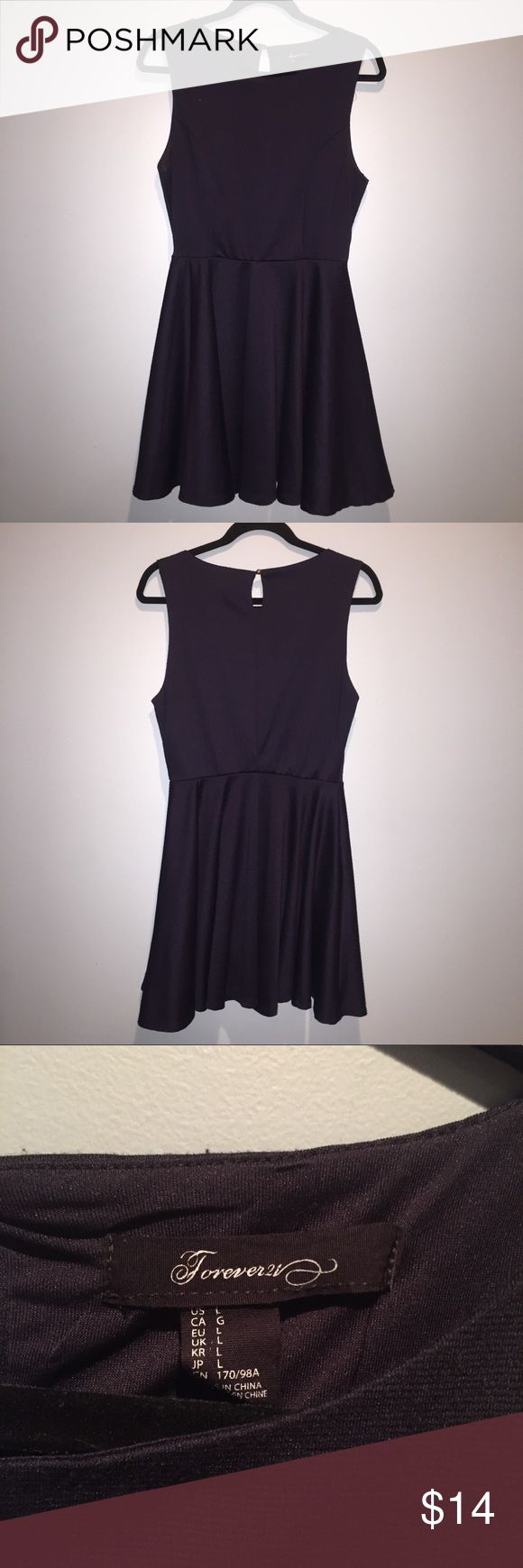 Navy Blue Dress, Forever 21 Navy blue short dress, clinched waist with flowy skirt. Slip on with with button detail. Forever 21, size large. Gently used. Forever 21 Dresses Mini