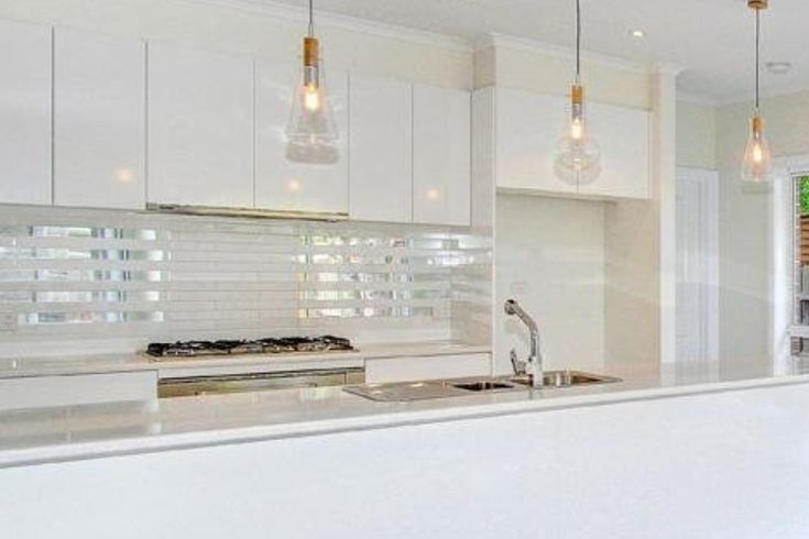 Kitchen pendant lights and mirrored tile splashback home for Splashback tiles kitchen ideas