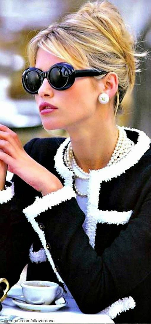 Round frame sunglasses, pearl earrings + monochrome jacket